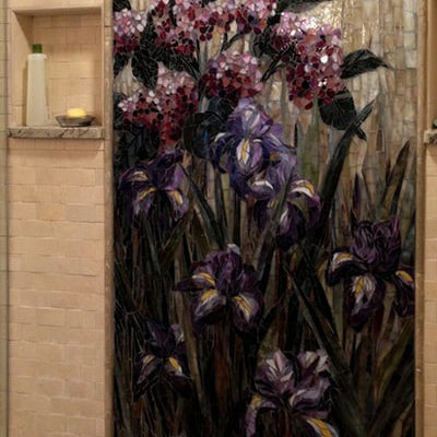 This mural was created for a client to embellish their new shower space and bathroom remodel.  The couple really loved hummingbirds and the flowers that grew in their garden, which is the basis for the artwork we developed for the mosaic.<br> <em>6ft x 4ft</em>