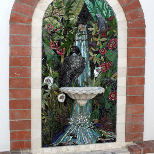 This commissioned fountain mural was created working with the clients to include specific creatures and plants.  The water flows into the waiting pool to create a peaceful oasis in their garden courtyard.