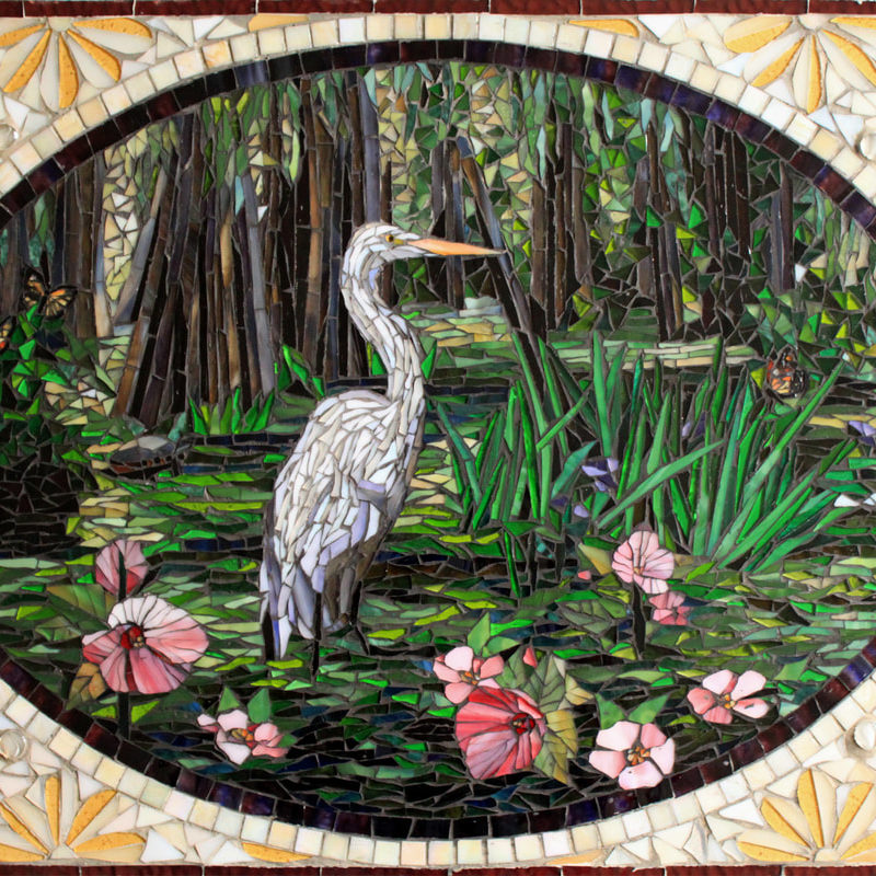 "This glass mosaic mural was created for a South Carolina kitchen in a beautiful waterfront home.  The home is bordered by swampland that included diverse wildlife and moss covered trees.  We worked with the client to create the artwork and then used the approved artwork to create the mosaic. <br> <em>24"" x 30"" </em>"